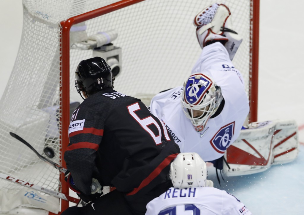 Canada's Mark Stone, left, fails to score past Henri Corentin Buysse of France, right, during the Ice Hockey World Championships group A match between