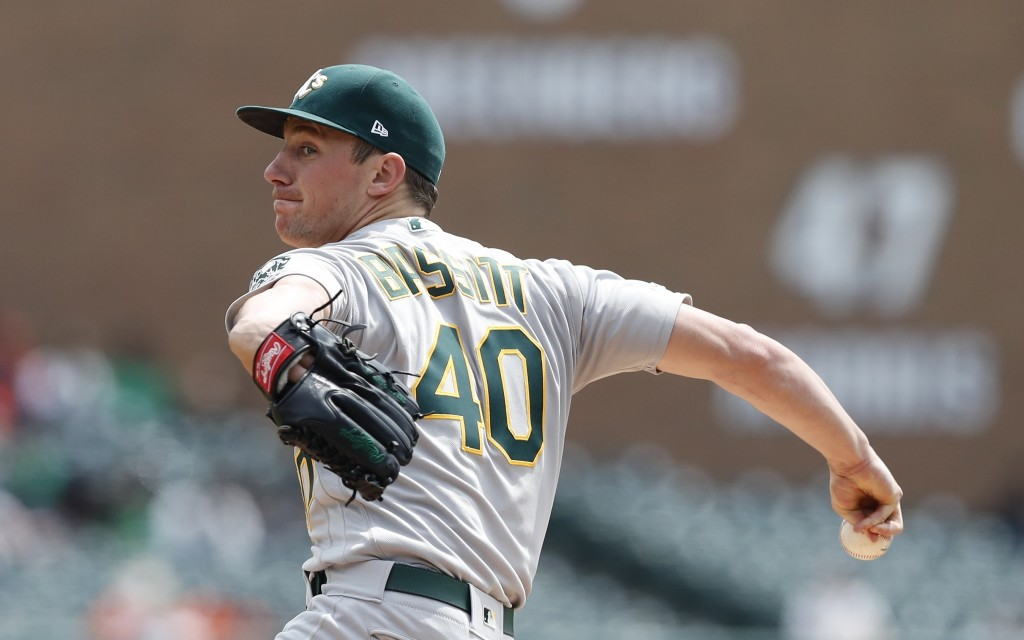 Oakland Athletics starting pitcher Chris Bassitt throws during the first inning of a baseball game against the Detroit Tigers, Thursday, May 16, 2019,...