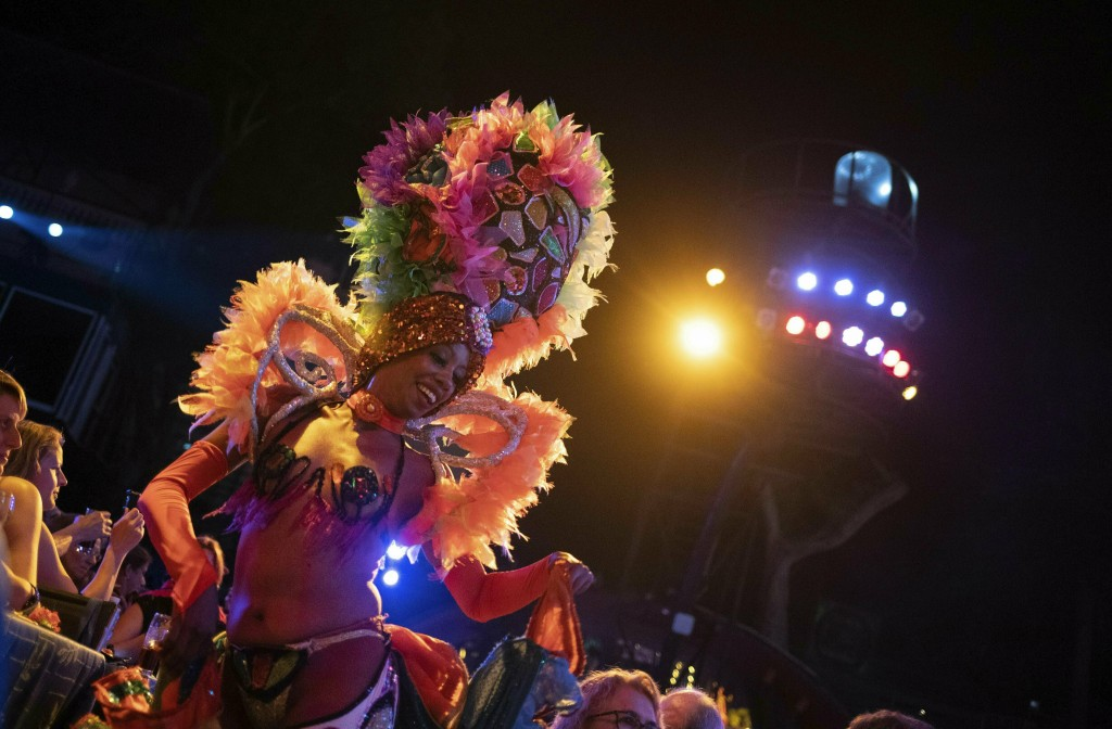 In this May 10, 2019 photo, a Tropicana cabaret dancer performs during the closing of an international tourism fair, in Havana, Cuba. Across the Flori