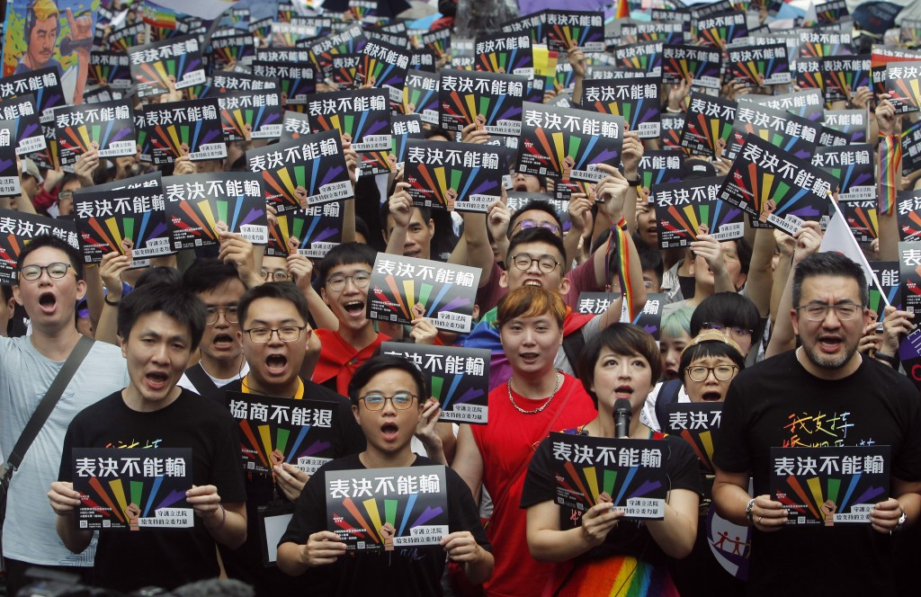 Same-sex marriage supporters gather outside the Legislative Yuan in Taipei, Taiwan, Friday, May 17, 2019. Taiwan's Constitutional Court are scheduled ...