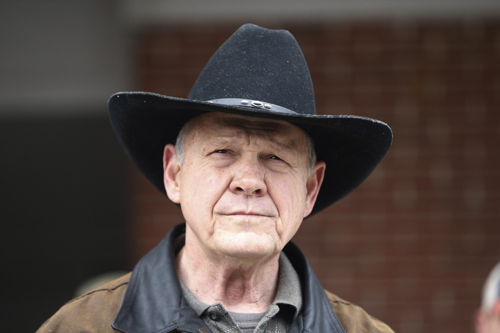 FILE - In this Dec. 12, 2017, file photo, Roy Moore speaks to the media after he rode in on a horse to vote in Gallant, Ala. Moore says he's consideri
