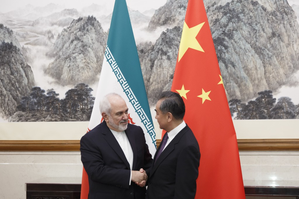 Chinese Foreign Minister Wang Yi meets Iranian Foreign Minister Mohammad Javad Zarif at the Diaoyutai State Guesthouse in Beijing, Friday, May 18, 201