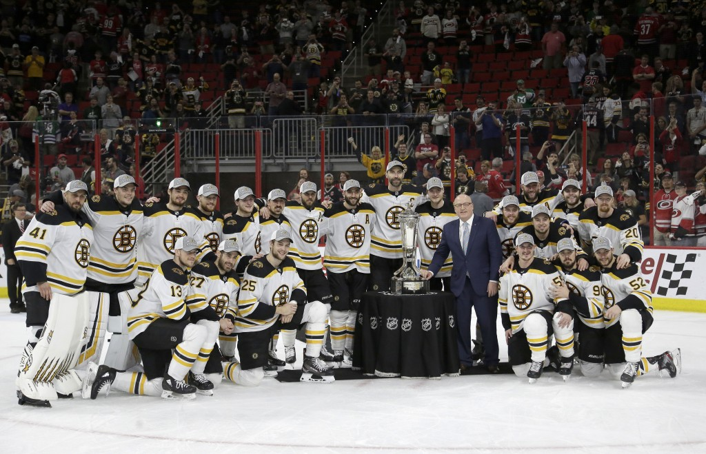 Boston Bruins players pose with the Prince of Wales trophy and Bill Daly, deputy commissioner of the National Hockey League, following Game 4 of the N...
