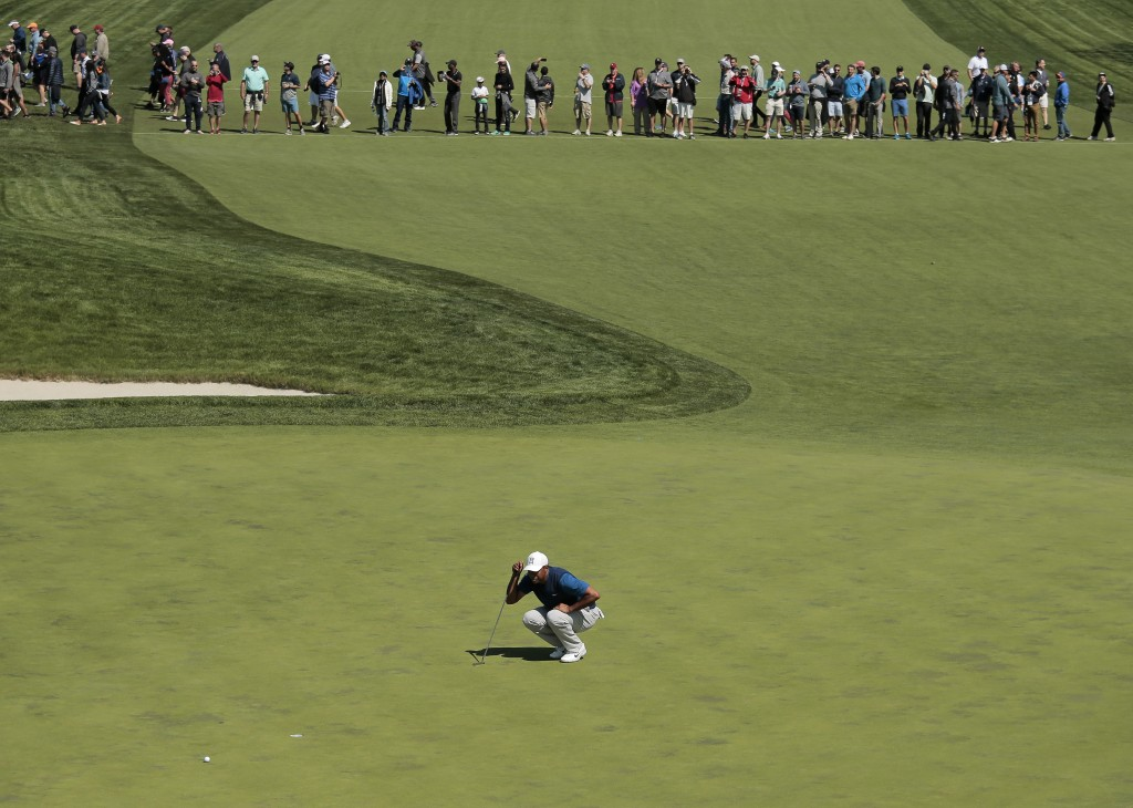 Tiger Woods lines up a putt on the 16th green during the first round of the PGA Championship golf tournament, Thursday, May 16, 2019, at Bethpage Blac