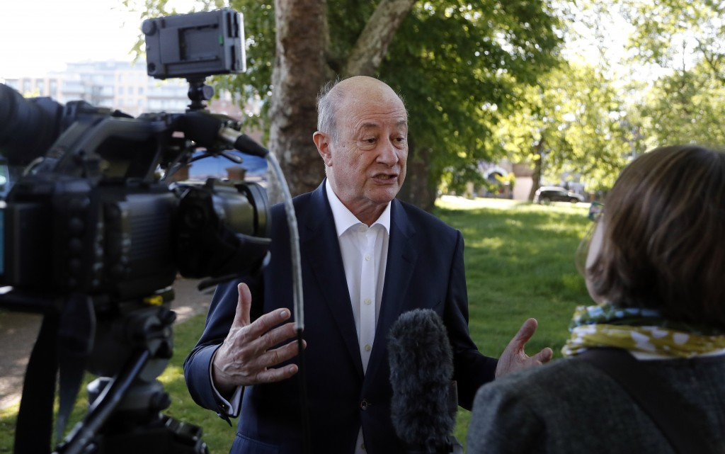 In this May 14, 2019, photo, Jan Vincent-Rostowski, the former Polish finance minister who is standing for Change UK speaks to The Associated Press in