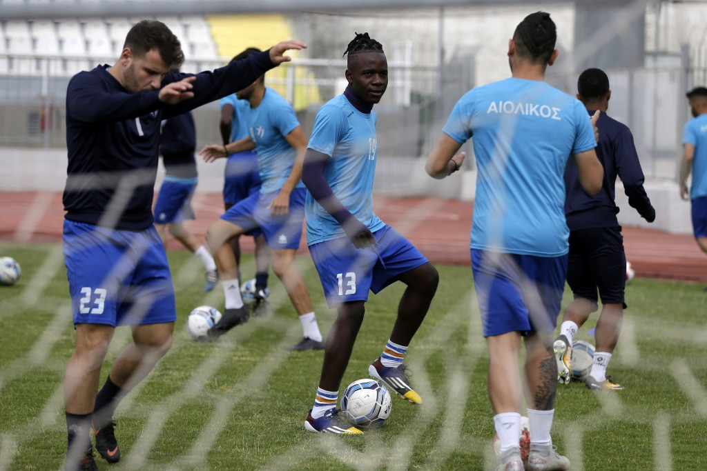 In this Saturday, May 4, 2019, Francis Kalombo from Congo, center, practices with his teammates of Aiolikos during a training session at the Municipal