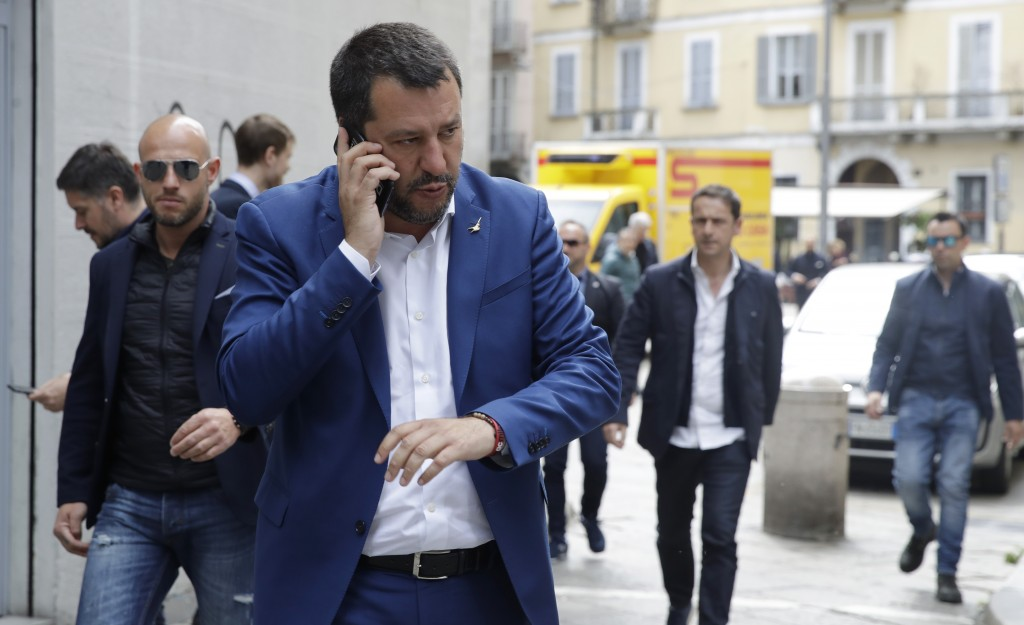Italian Interior Minister and Deputy-Premier, Matteo Salvini, talks on the phone as he arrives for a press conference at the foreign press association...