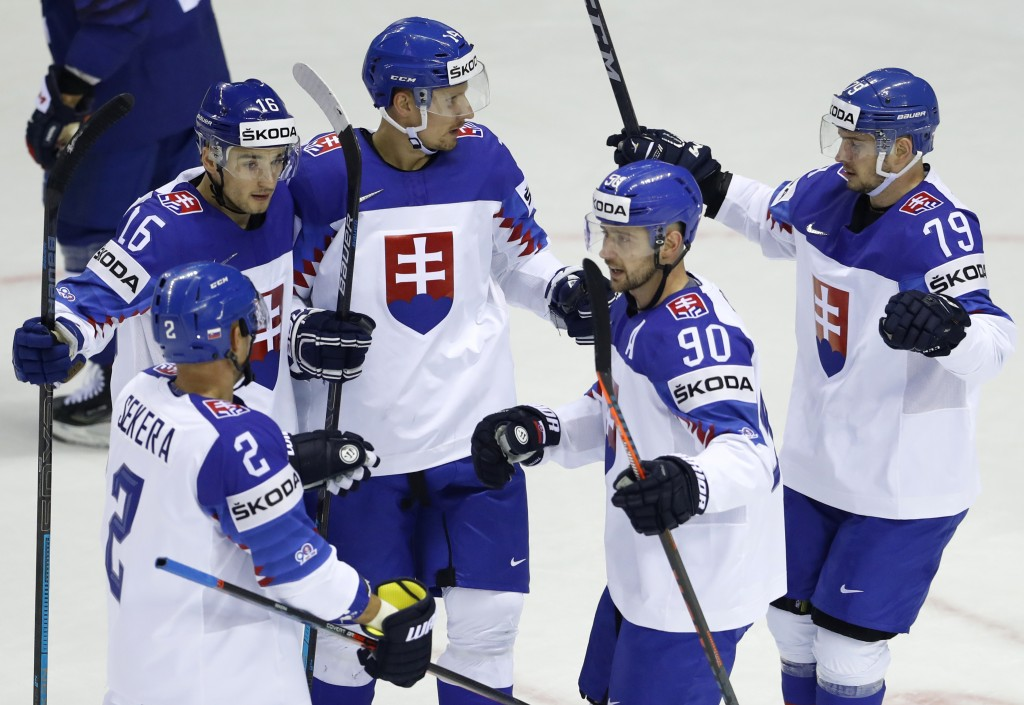 Slovakia's Richard Panik, center, celebrates with teammates after scoring his sides first goal during the Ice Hockey World Championships group A match