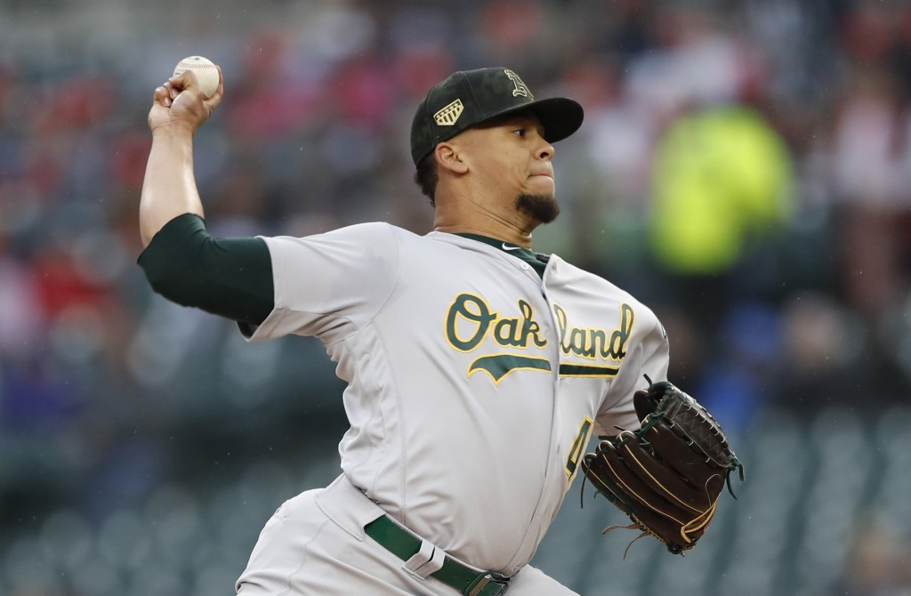 Oakland Athletics starting pitcher Frankie Montas throws during the first inning of a baseball game against the Detroit Tigers, Friday, May 17, 2019, ...