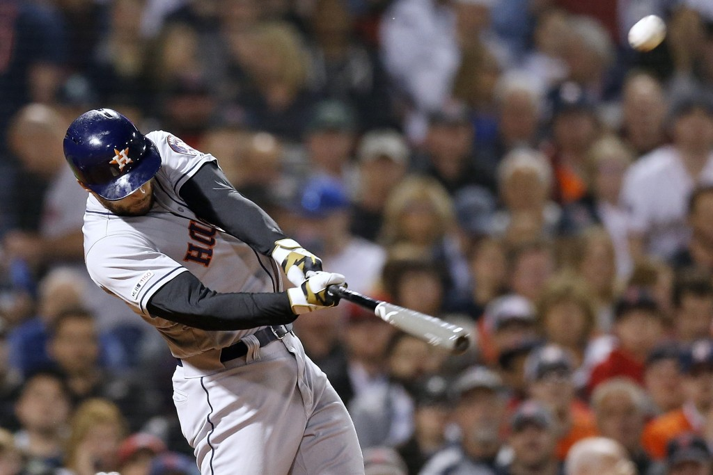 Houston Astros' George Springer hits a two-run home run during the eighth inning of the team's baseball game against the Boston Red Sox in Boston, Fri