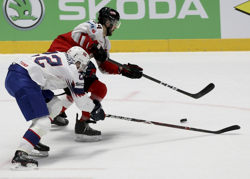 Norway's Martin Roymark checks Austria's Steven Strong, from left, during the Hockey World Championships group B match between Austria and Norway at t