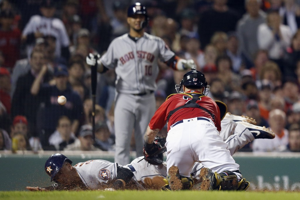 Boston Red Sox's Christian Vazquez (7) can not handle the throw as Houston Astros' Michael Brantley, left, scores on a sacrifice fly by Josh Reddick d