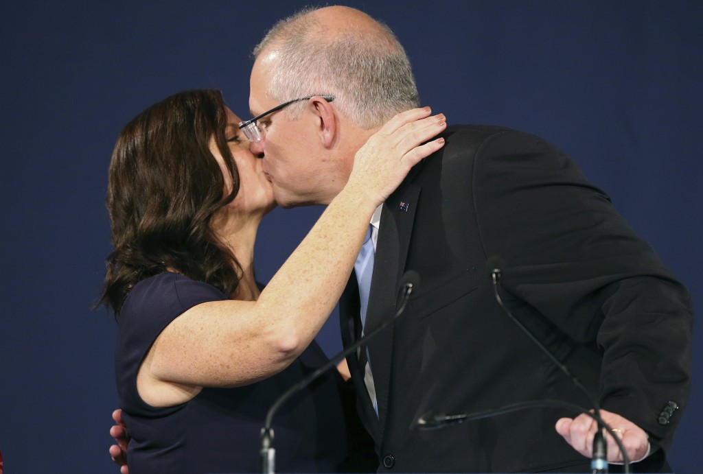 Australian Prime Minister Scott Morrison, right, kisses his wife, Jenny, after his opponent conceded defeat in the federal election in Sydney, Austral