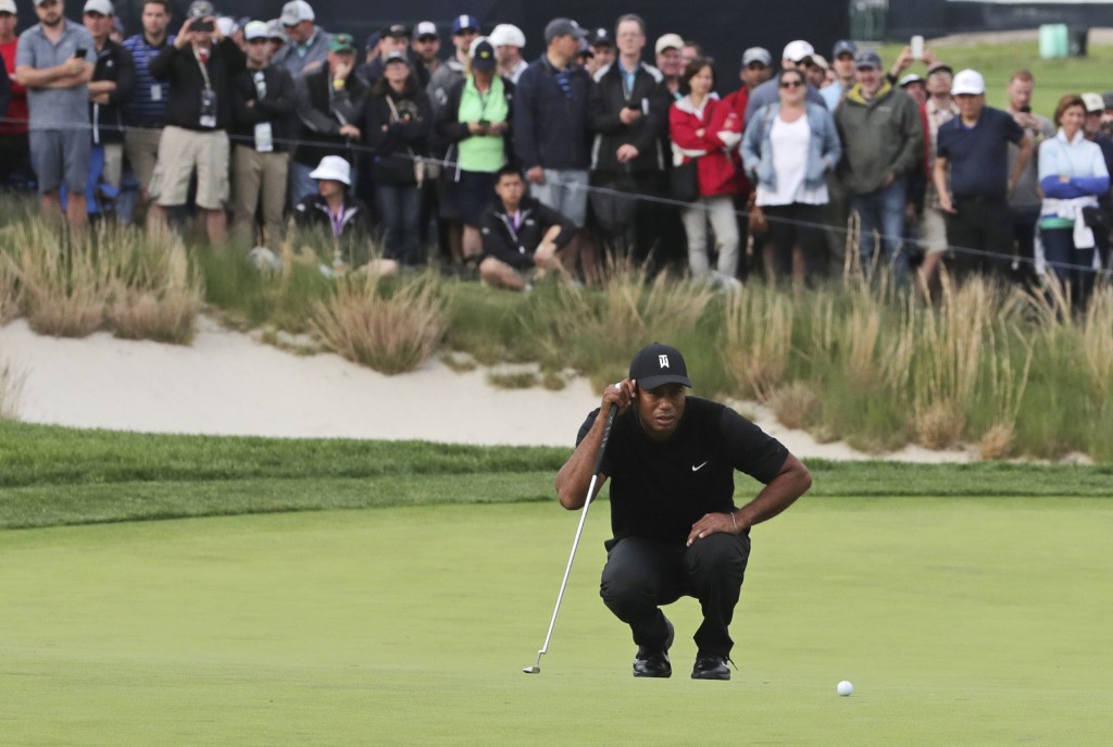Tiger Woods lines up a putt on the 17th green during the second round of the PGA Championship golf tournament, Friday, May 17, 2019, at Bethpage Black