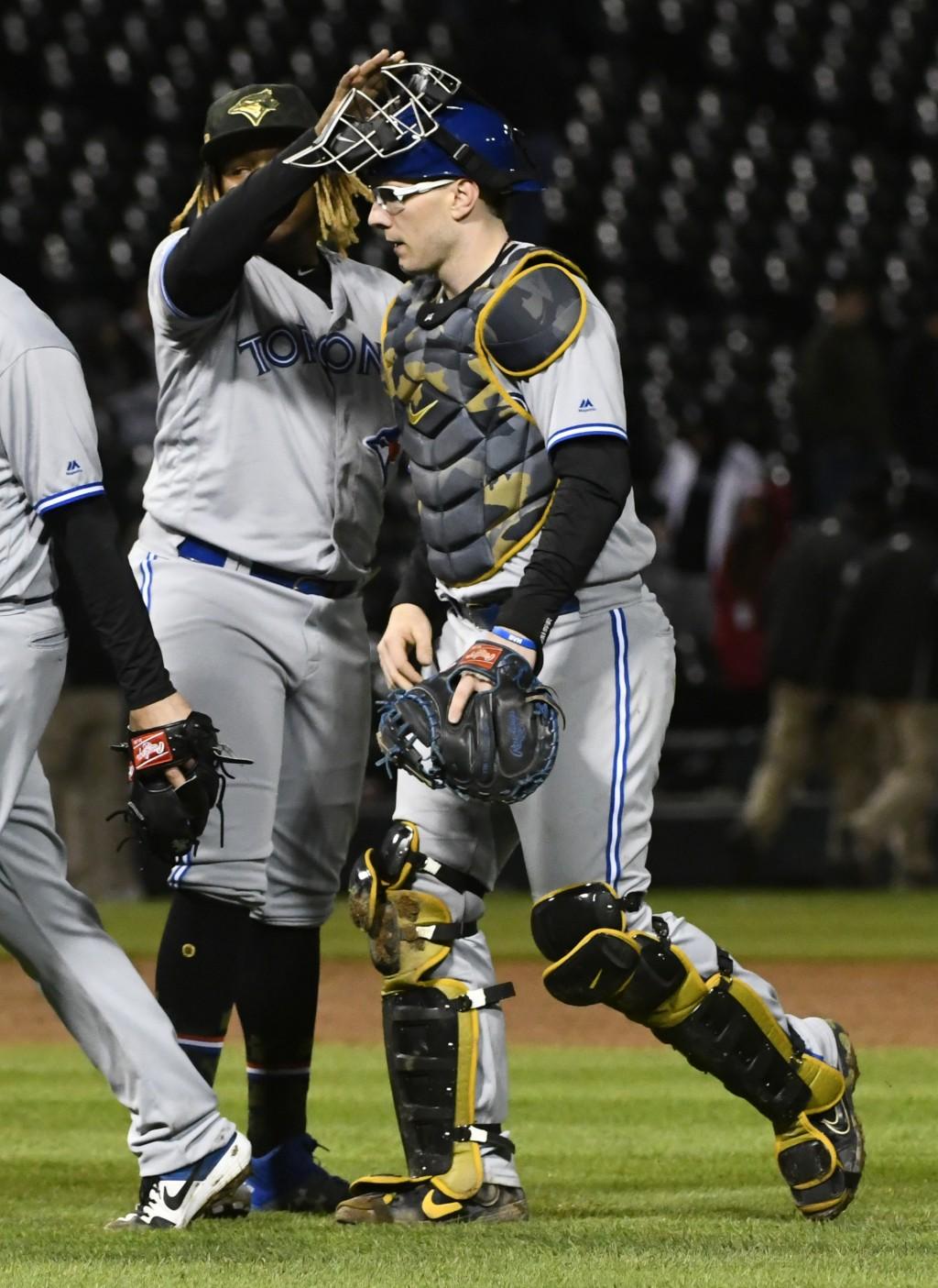 Toronto Blue Jays third baseman Vladimir Guerrero Jr., left, and catcher Danny Jansen celebrate after the team's baseball game against the Chicago Whi