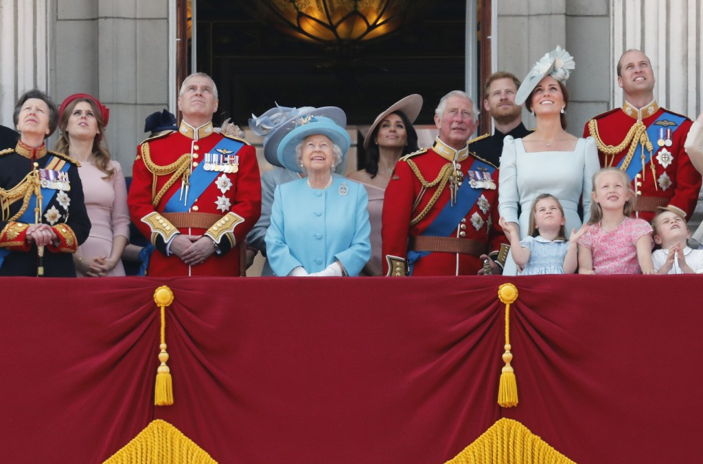 FILE - In this Saturday, June 9, 2018 file photo, from left, Britain's Princess Anne, Princess Beatrice, Prince Andrew, Queen Elizabeth, Meghan, Duche