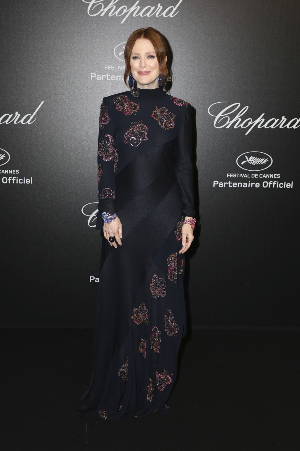 Actress Julianne Moore poses for photographers upon arrival at the Chopard Love event at the 72nd international film festival, Cannes, southern France
