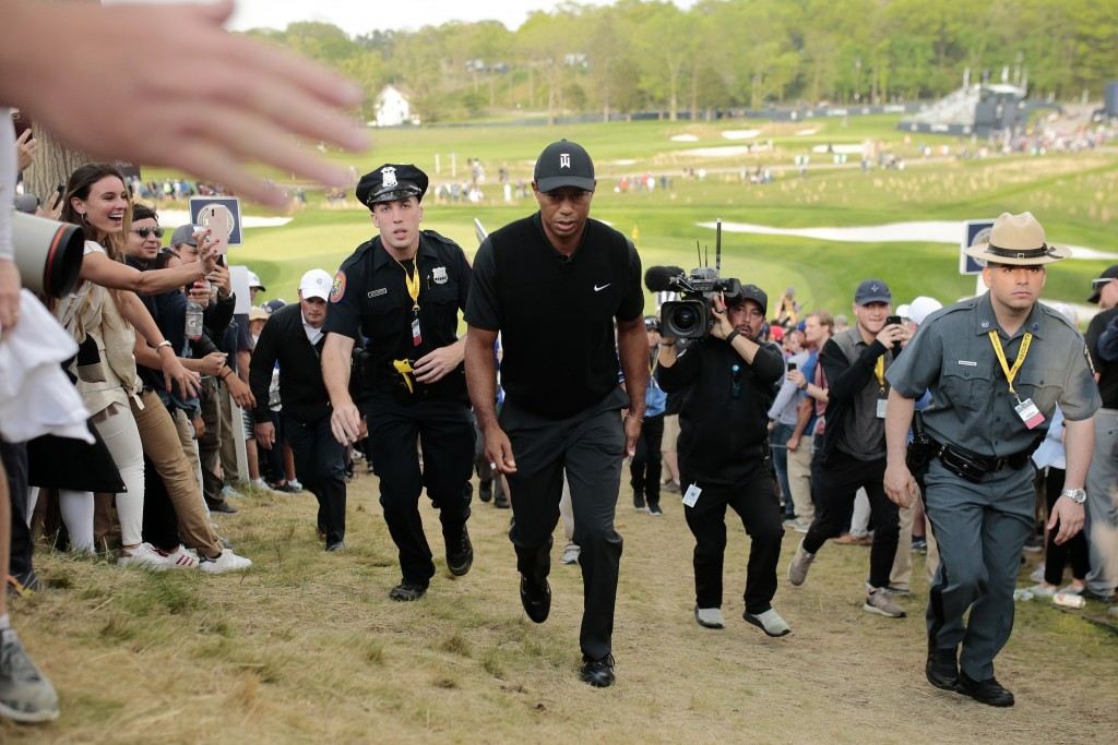 Tiger Woods walks up to the 18th tee during the second round of the PGA Championship golf tournament, Friday, May 17, 2019, at Bethpage Black in Farmi
