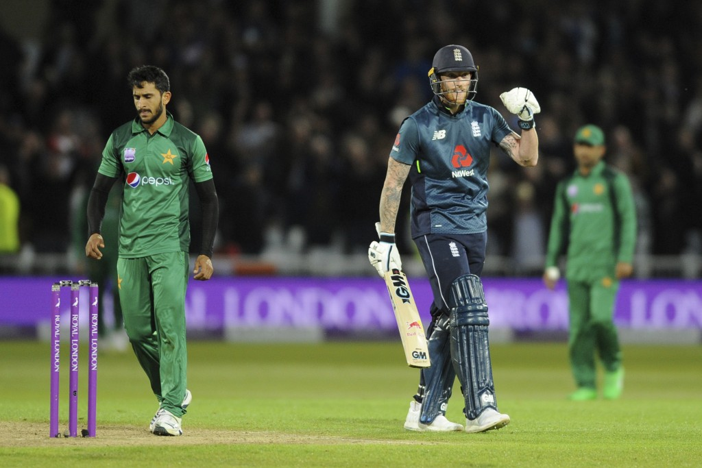 England's Ben Stokes, center, celebrates after winning the Fourth One Day International cricket match between England and Pakistan at Trent Bridge in