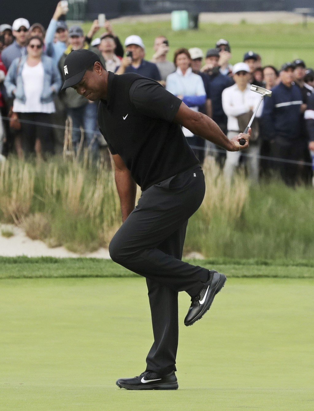 Tiger Woods reacts after missing a putt for birdie on the 17th green during the second round of the PGA Championship golf tournament, Friday, May 17,