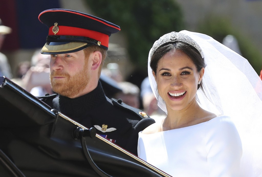 FILE - In this Saturday, May 19, 2018 file photo, Britain's Prince Harry and his wife Meghan Markle leave after their wedding ceremony, at St. George'