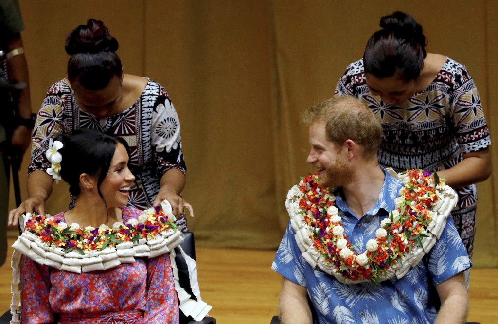 FILE - In this Wednesday, Oct. 24, 2018 file photo, Britain's Prince Harry and Meghan, Duchess of Sussex visit the University of the South Pacific in