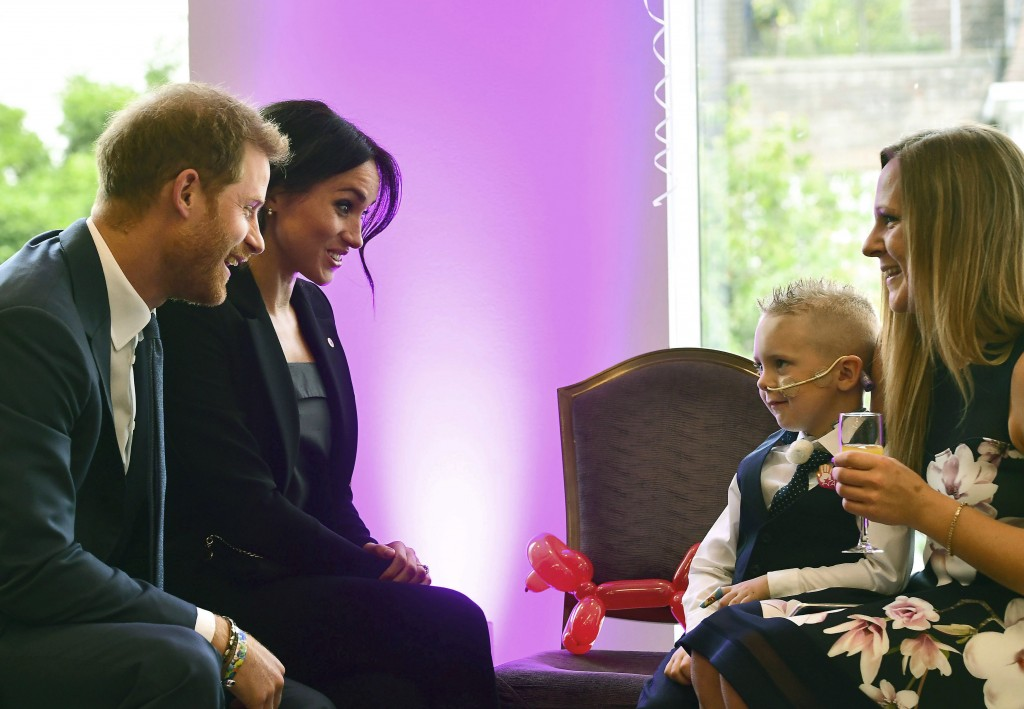 FILE - In this Tuesday, Sept. 4, 2018 file photo , Britian's Prince Harry, the patron of the charity WellChild and his wife Meghan, the Duchess of Sus