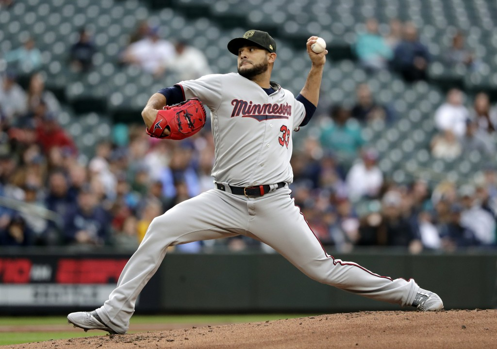 Minnesota Twins starting pitcher Martin Perez throws to a Seattle Mariners batter during the first inning of a baseball game Friday, May 17, 2019, in