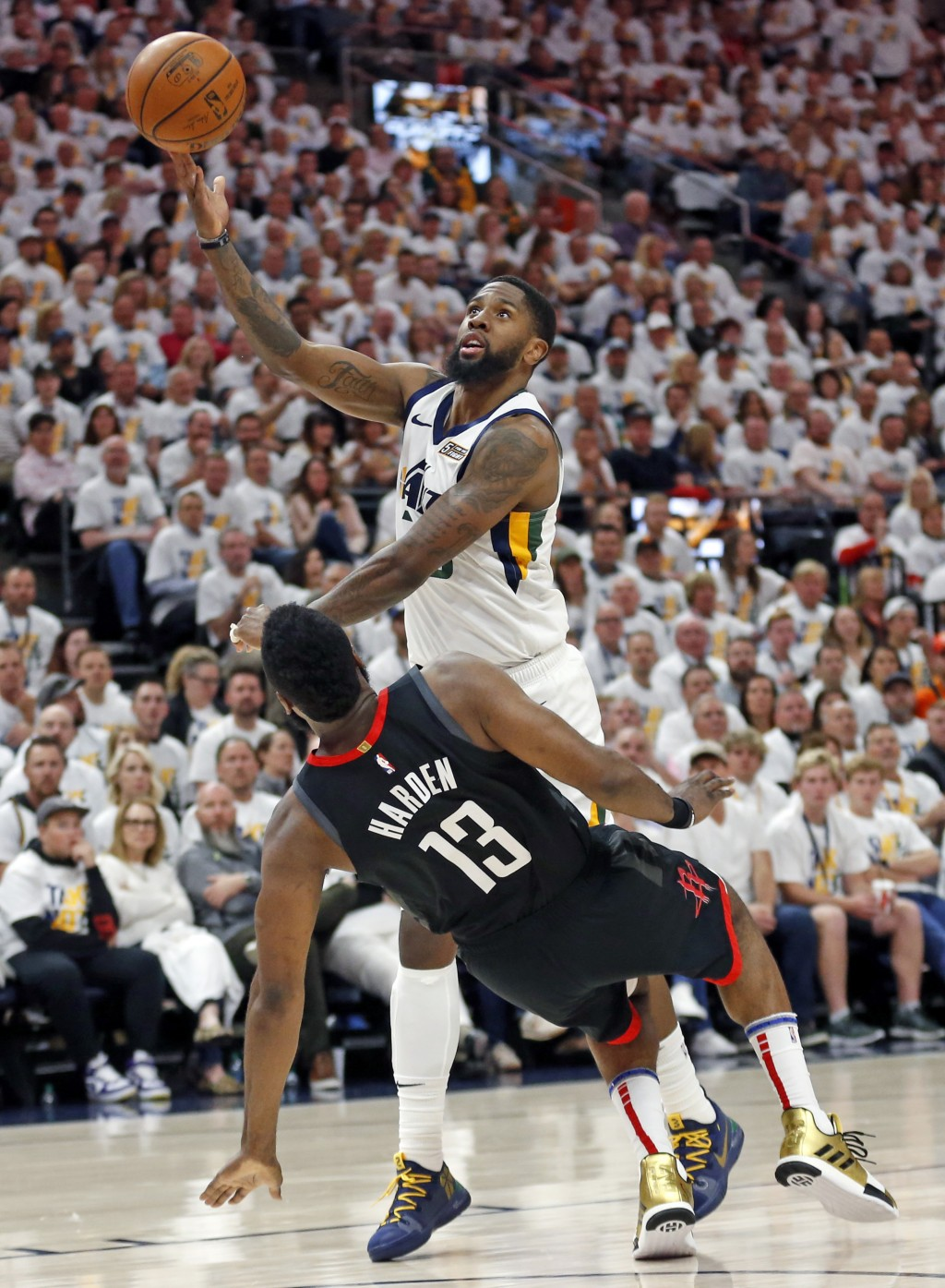 FILE - In this April 22, 2019, file photo, Houston Rockets guard James Harden (13) takes a charge from Utah Jazz forward Royce O'Neale, rear, during t
