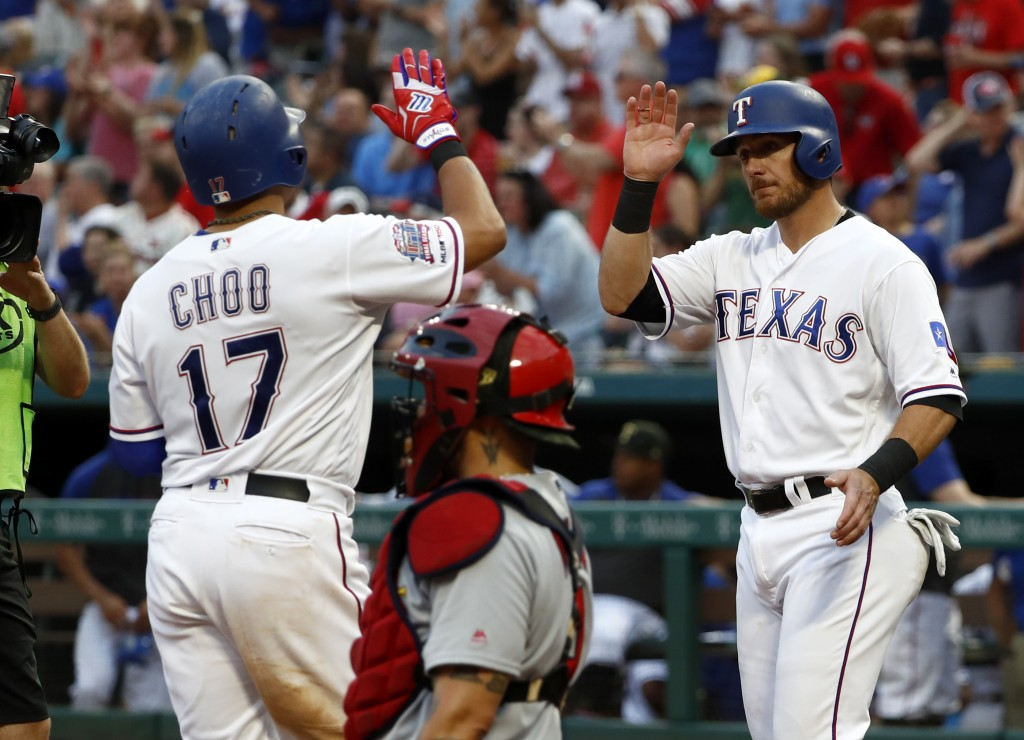 Texas Rangers' Shin-Soo Choo, left, and Jeff Mathis, right, celebrate Choo's two-run home run that scored Mathis as St. Louis Cardinals catcher Yadier
