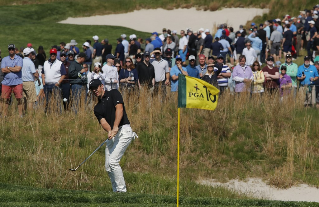 Rory McIlroy, of Northern Ireland, chips onto the 16th green during the second round of the PGA Championship golf tournament, Friday, May 17, 2019, at...