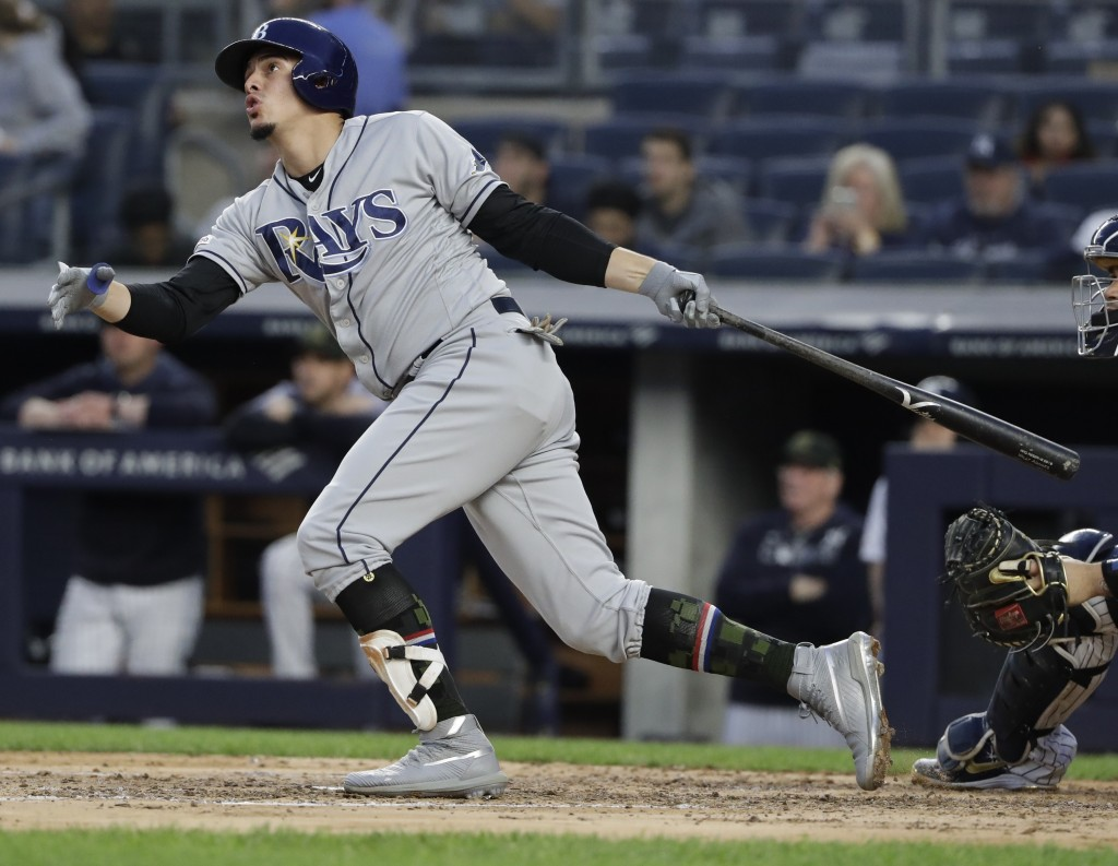 Tampa Bay Rays' Willy Adames watches his home run during the fourth inning of the team's baseball game against the New York Yankees on Friday, May 17,