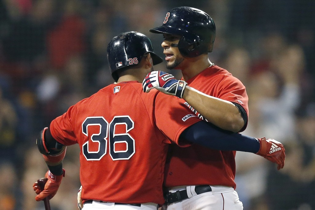 Boston Red Sox's Xander Bogaerts celebrates with Eduardo Nunez (36) after scoring on a dingle by Christian Vazquez during the sixth inning of the team