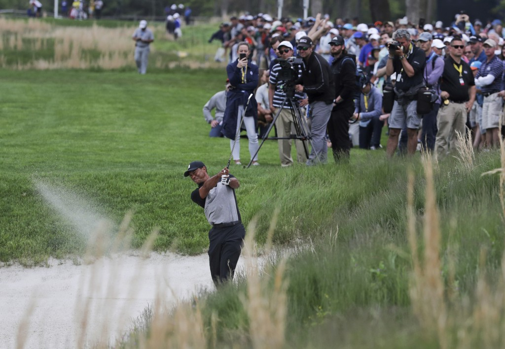 Tiger Woods hits out of a bunker on the 13th hole during the second round of the PGA Championship golf tournament, Friday, May 17, 2019, at Bethpage B