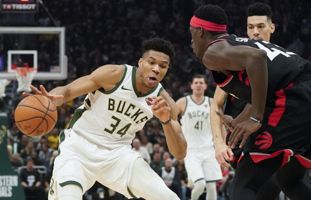 Milwaukee Bucks' Giannis Antetokounmpo tries to drive past Toronto Raptors' Pascal Siakam during the first half of Game 2 of the NBA Eastern Conferenc