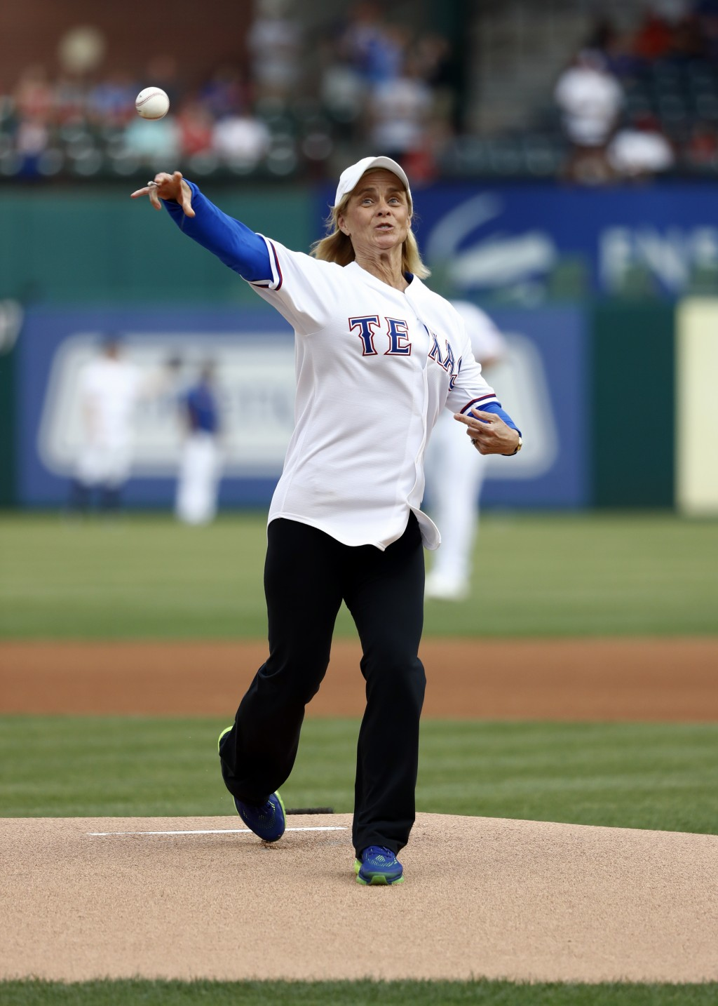 Baylor women's basketball head coach Kim Mulkey throws out the ceremonial first pitch before a baseball game between the St. Louis Cardinals and the T