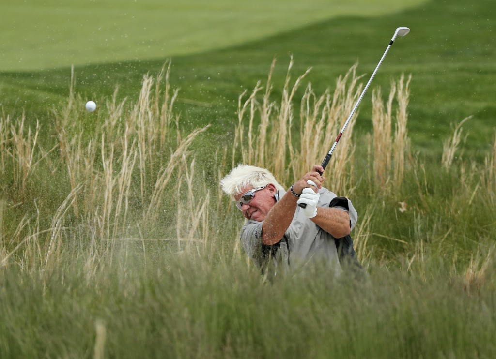 290John Daly hits out of a bunker on the 18th hole during the second round of the PGA Championship golf tournament, Friday, May 17, 2019, at Bethpage