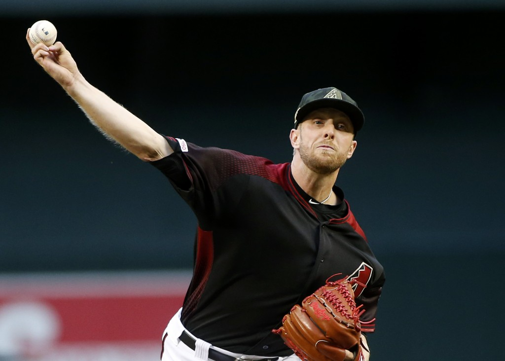 Arizona Diamondbacks starting pitcher Merrill Kelly throws against the San Francisco Giants during the first inning of a baseball game, Friday, May 17