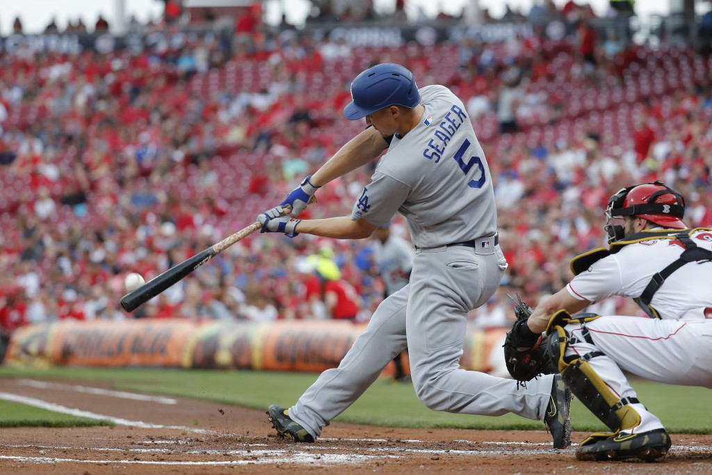 Los Angeles Dodgers' Corey Seager hits a two-run home run off Cincinnati Reds starting pitcher Anthony DeSclafani in the second inning of a baseball g