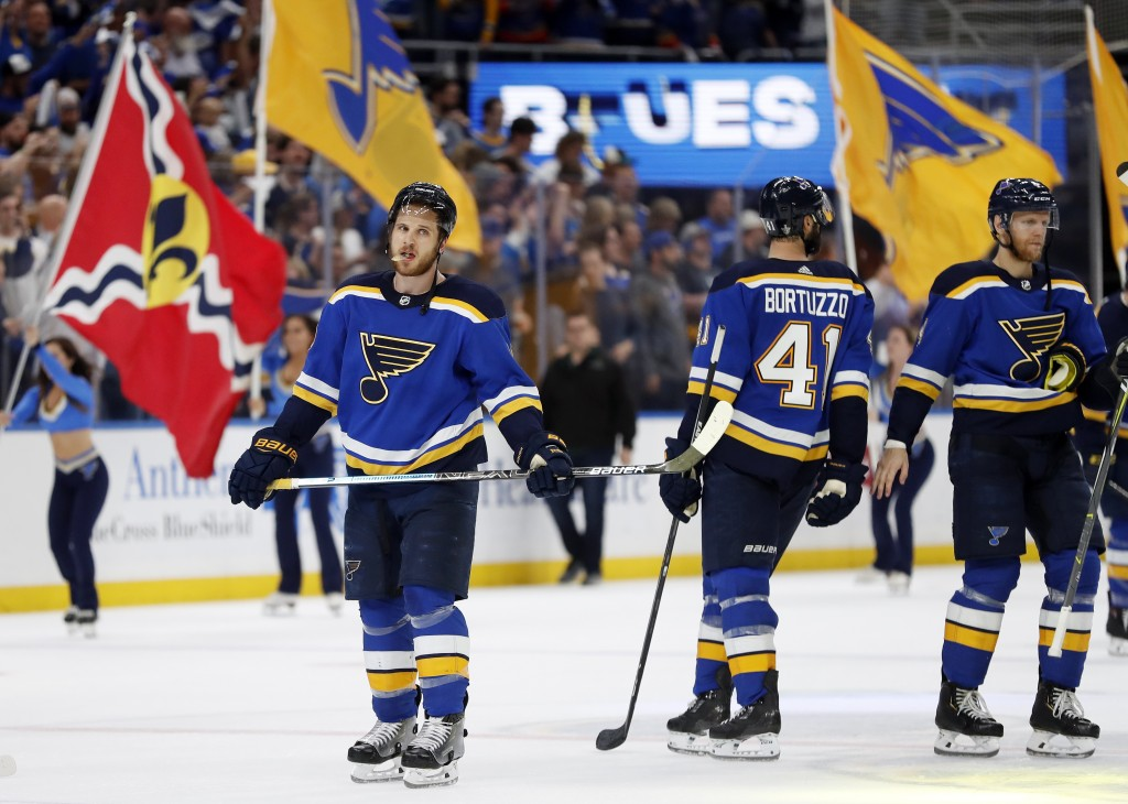 St. Louis Blues players are cheered after beating the San Jose Sharks in Game 4 of the NHL hockey Stanley Cup Western Conference final series Friday,