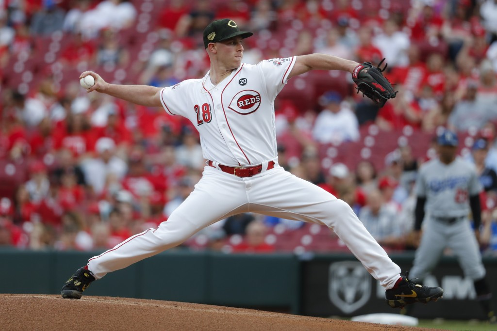 Cincinnati Reds starting pitcher Anthony DeSclafani throws in the first inning of a baseball game against the Los Angeles Dodgers, Friday, May 17, 201