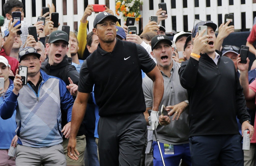 Tiger Woods watches his shot out of the rough on the first hole during the second round of the PGA Championship golf tournament, Friday, May 17, 2019,