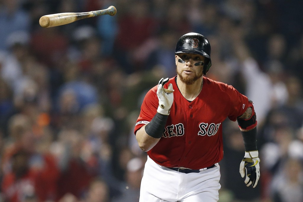 Boston Red Sox's Christian Vazquez runs on his RBI single during the sixth inning of the team's baseball game against the Houston Astros in Boston, Fr