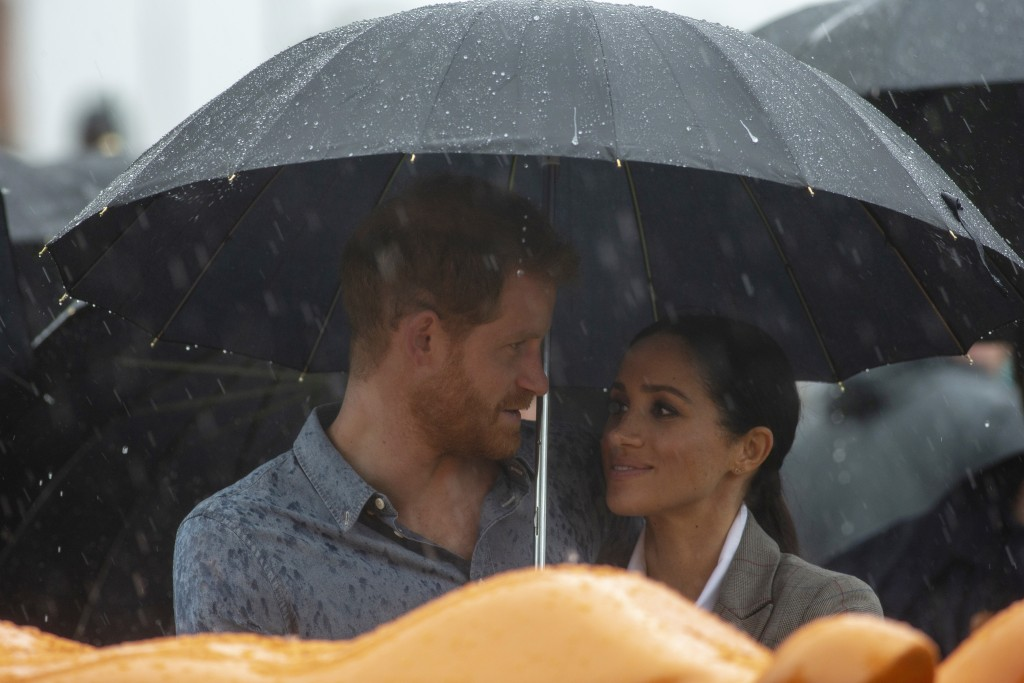 FILE - In this Wednesday, Oct. 17, 2018 file photo, Britain's Prince Harry and Meghan, Duchess of Sussex attend a community picnic at Victoria Park in