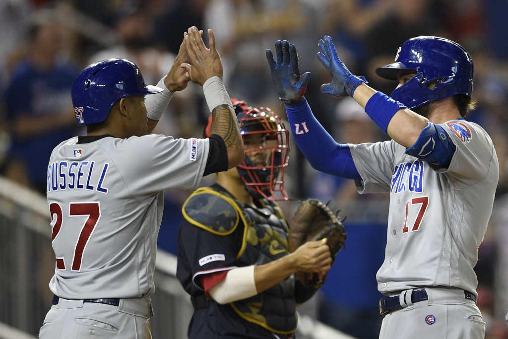 Chicago Cubs' Kris Bryant (17) celebrates his two-run home run with Addison Russell (27) during the seventh inning of a baseball game as Washington Na