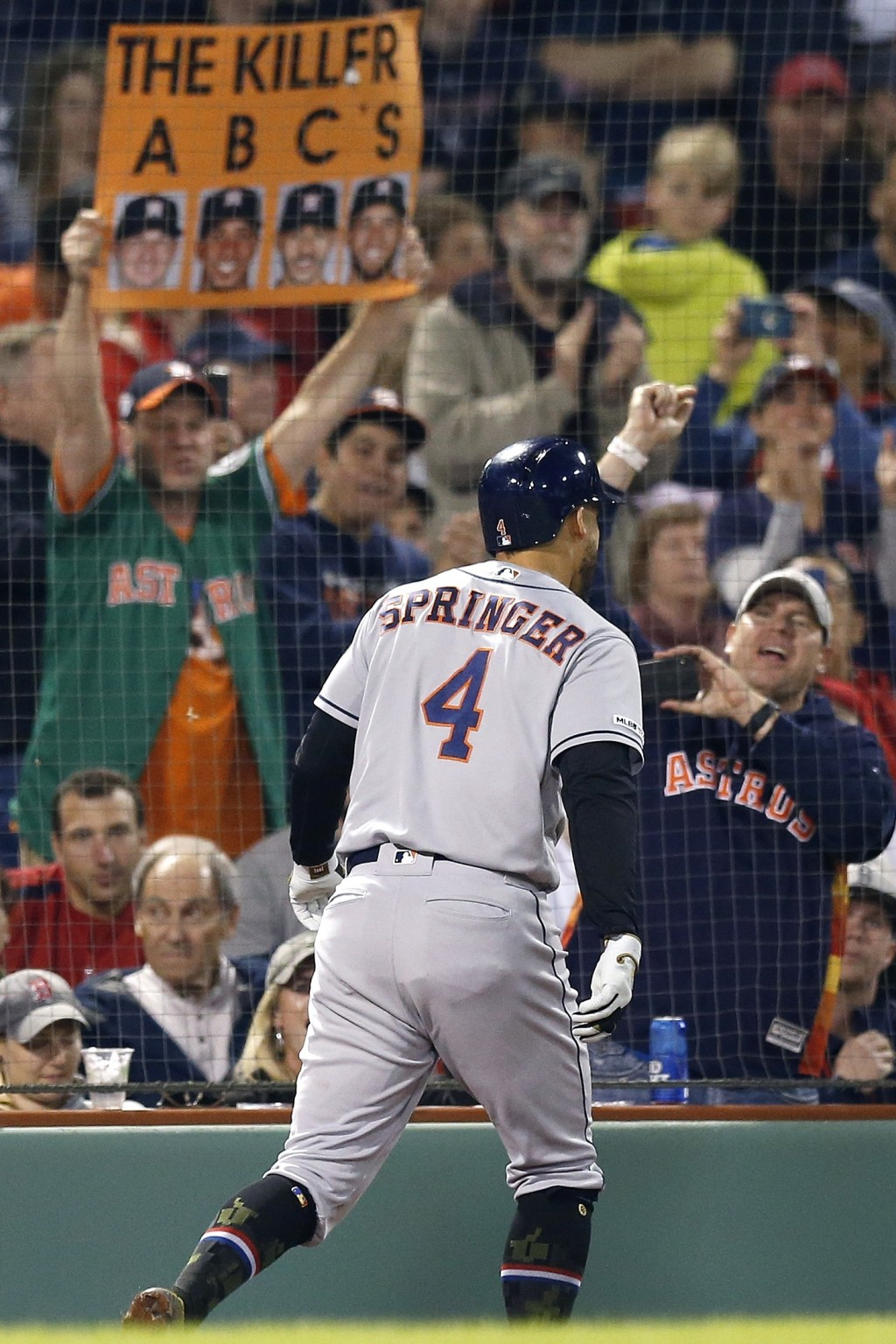 Houston Astros fans celebrate a two-run home run by George Springer (4) during the eighth inning of the team's baseball game against the Boston Red So
