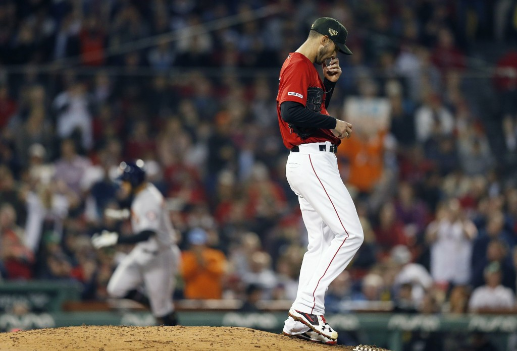 Boston Red Sox's Rick Porcello stands on the back of the mound after giving up a two-run home run to Houston Astros' George Springer, left, during the
