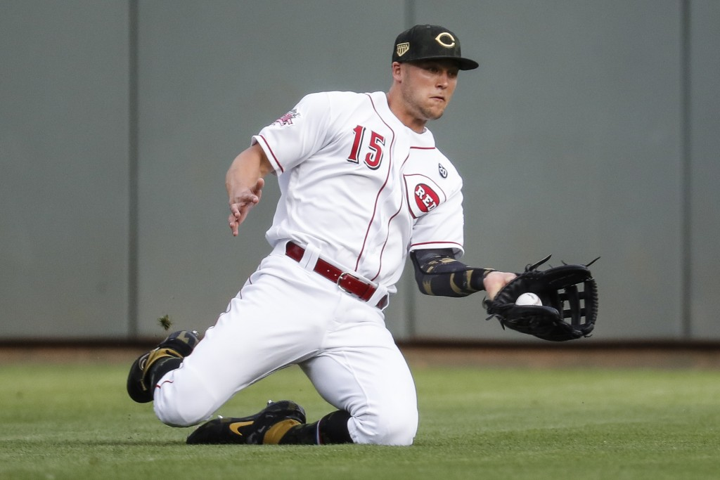 Cincinnati Reds third baseman Nick Senzel catches a fly ball hit by Los Angeles Dodgers' Los Angeles Dodgers' Max Muncy for an out in the first inning