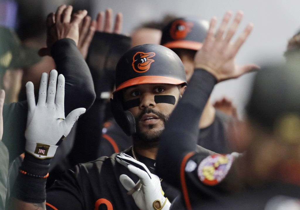 Baltimore Orioles' Jonathan Villar is congratulated after hitting a three-run home run off Cleveland Indians starting pitcher Jefry Rodriguez in the t