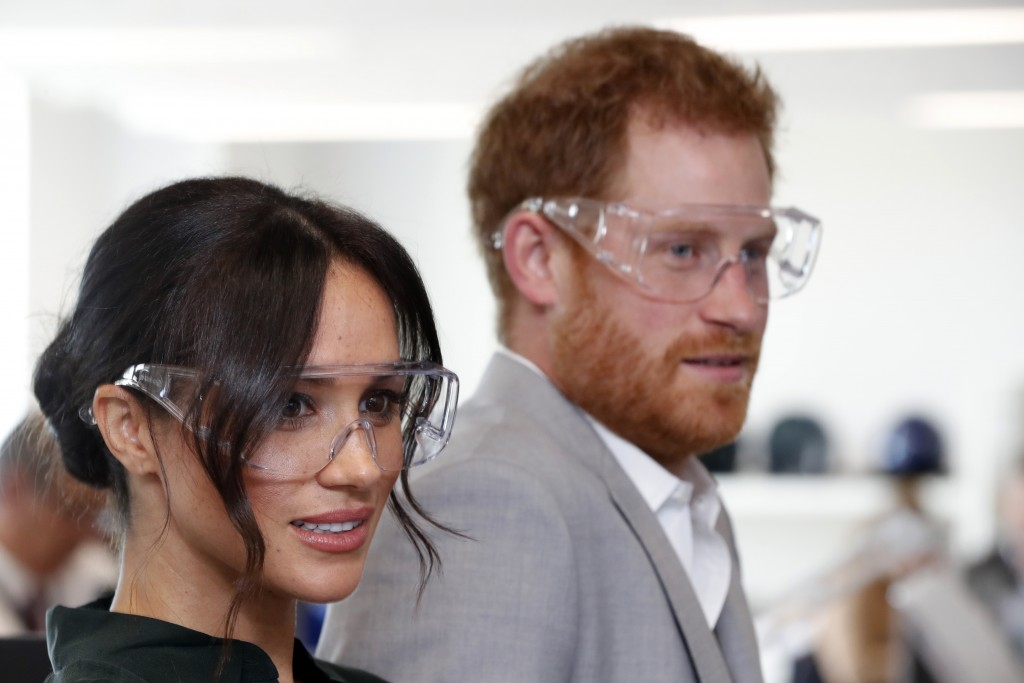 FILE - In this Wednesday, Oct. 3, 2018 file photo, Britain's Prince Harry and Meghan, the Duchess of Sussex visit the University of Chichester Tech Pa
